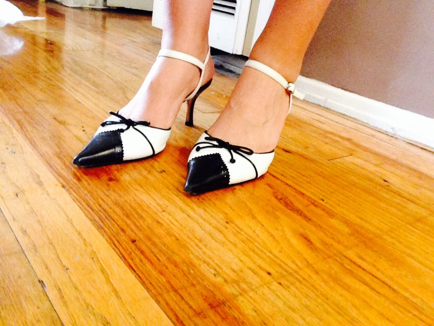 pointy black and white leather wing tip kitten heels